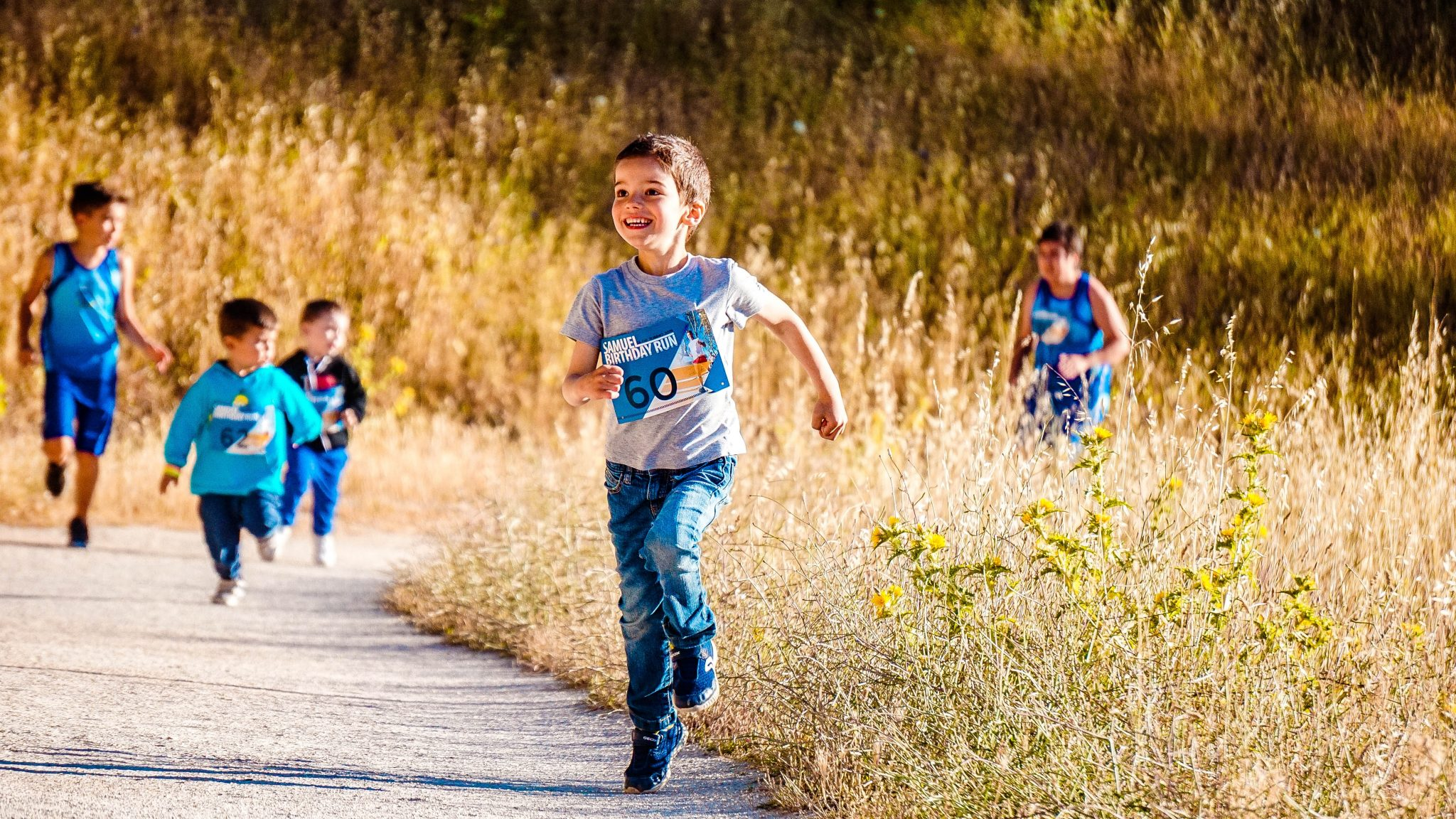 boy running on path