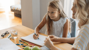 mother homeschooling her daughter
