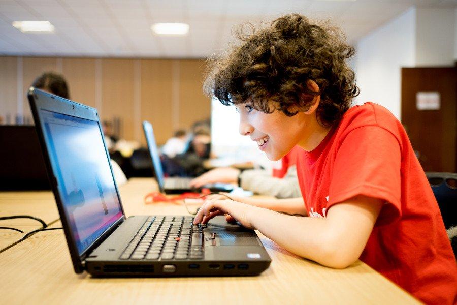 Young boy enjoying coding